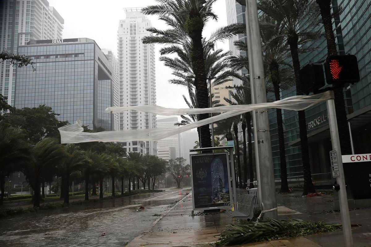 High winds blow through Brickell Avenue as Hurricane Irma arrives on Sept 10, 2017 in Miami, Florida.