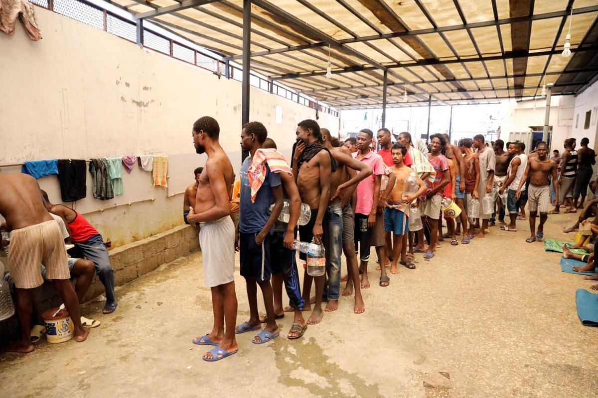 Migrants are seen at the centre of the Anti-Illegal Immigration Authority in Tripoli, on Sept 10, 2017.