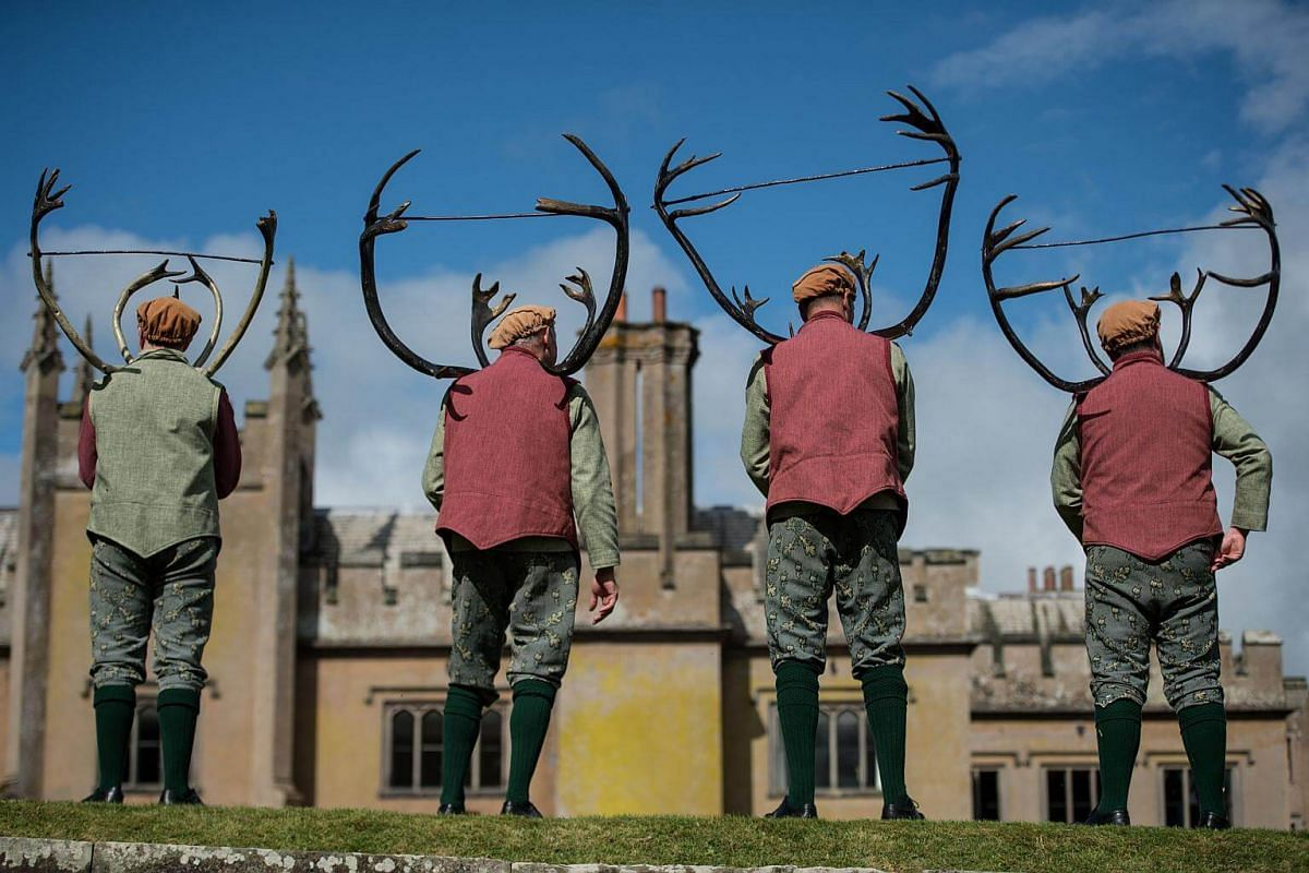 Dancers turn to face the audience after performing the Abbots Bromley Horn Dance in the grounds of Blithfield Hall, England, on Sept 11, 2017.