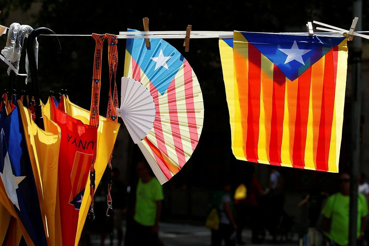 Umbrellas, fans and flags decorated with the Estelada (Catalan separatist flag) are seen on sale during the regional national day 'La Diada' in Barcelona, on Sept 11, 2017.
