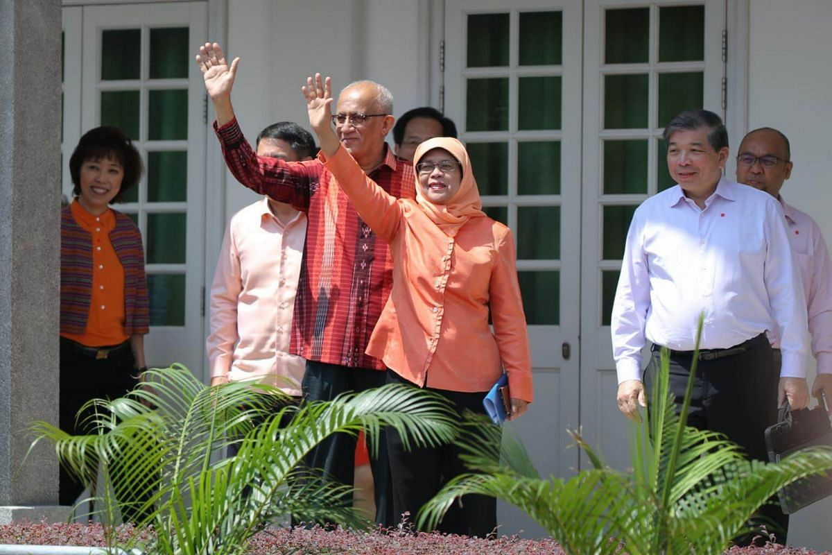 Halimah Yacob and her husband arriving at the Nomination Centre.