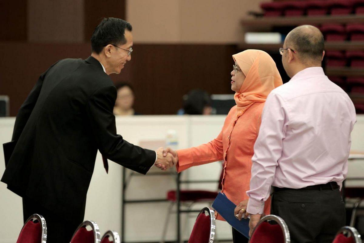 Returning Officer Ng Wai Choong congratulating President-elect Halimah Yacob.