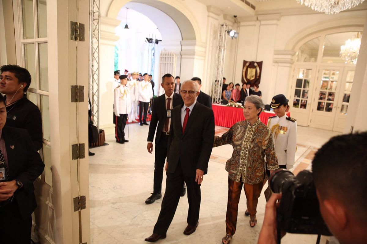 President Halimah Yacob's husband, Mr Mohamed Abdullah Alhabshee, and Mrs Lee Hsien Loong walking out of the hall, after the swearing-in ceremony at the Istana on Sept 14, 2017.