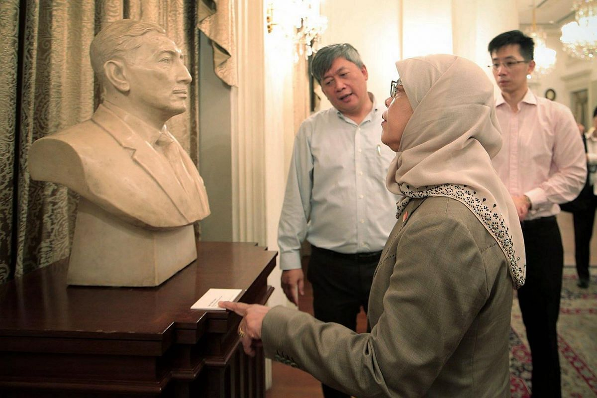 Madam Halimah Yacob standing before a bust of the late Yusof Ishak, Singapore's first president, during a tour of the Istana on Sept 14, 2017.