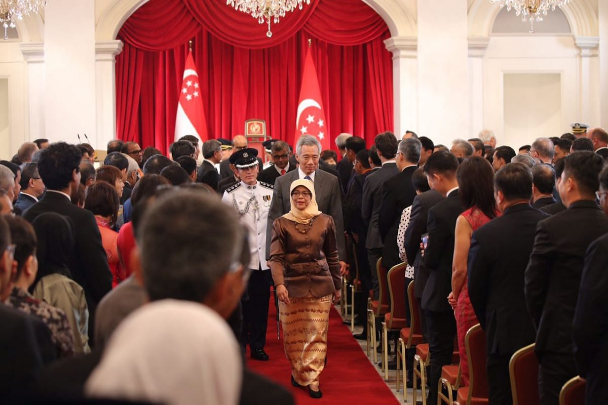 Madam Halimah Yacob walking out of the ceremony hall after being sworn in as Singapore's eighth President, at the Istana on Sept 14, 2017.