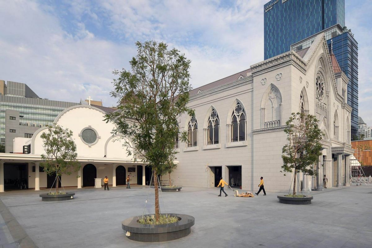 An exterior view of the old (left) and new prayer halls of the Novena Church, showing the vast difference in size.