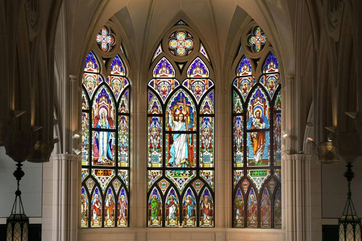The massive panels of stained glass at the East End of the church feature full portraits of Our Lady of Ransom (left), St Joseph (right), and Jesus, the Most Holy Redeemer in the centre.