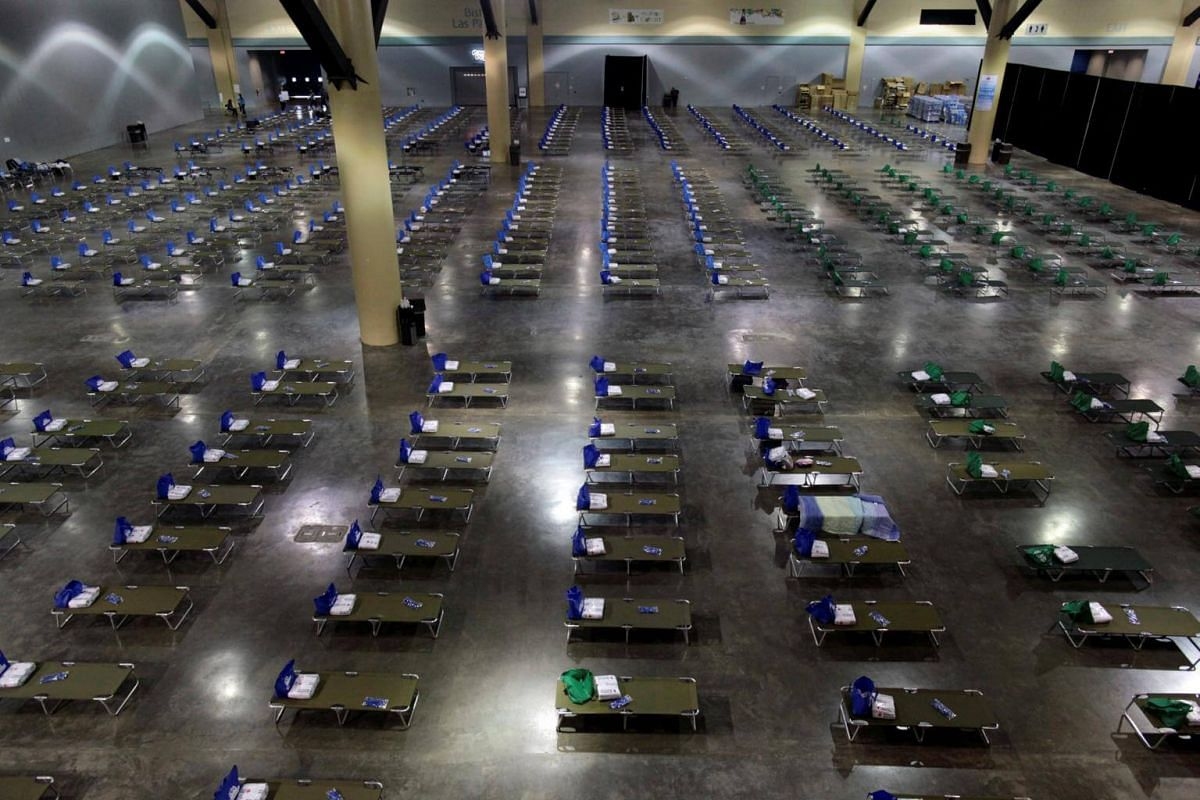 Camp beds are set up at a convention centre for Caribbean refugees whose homes were destroyed by Hurricane Irma, in San Juan, Puerto Rico on Sept 14, 2017.