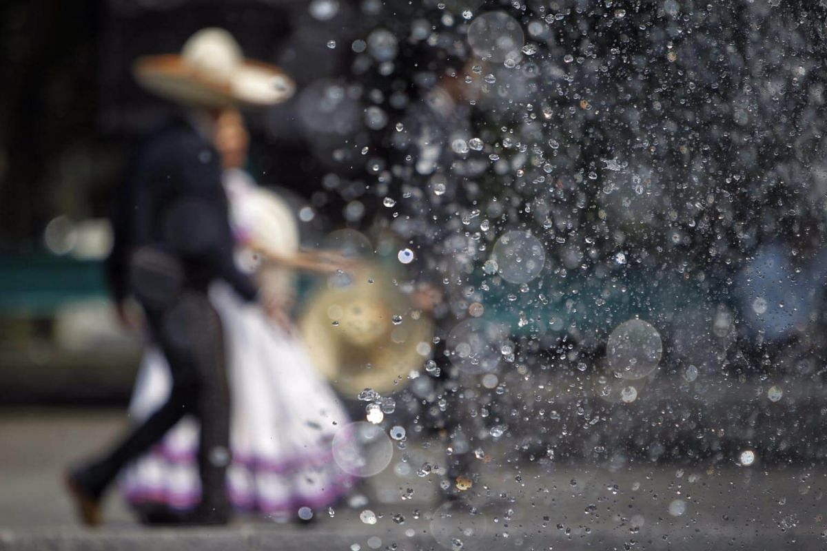 Participants dressed as Mexican Charros (horsemen) attend a ceremony in Mexico City, Mexico, on Sept 14, 2017.