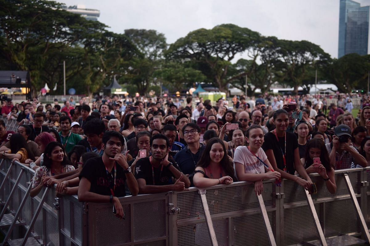 Spectators watch as singer Lianne La Havas performs on the Padang stage at the 2017 Formula One Singapore Grand Prix.