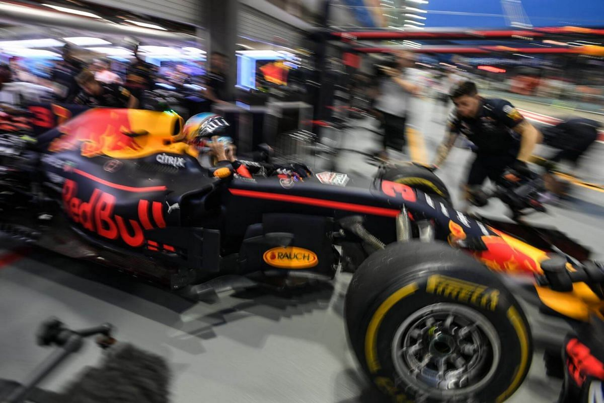 Australian Formula One driver Daniel Ricciardo of Red Bull Racing Tag Heuer returns to the garage after the third practice session of the 2017 Formula One Singapore Airlines Singapore Grand Prix at the Marina Bay street circuit on Sept 16, 2017.