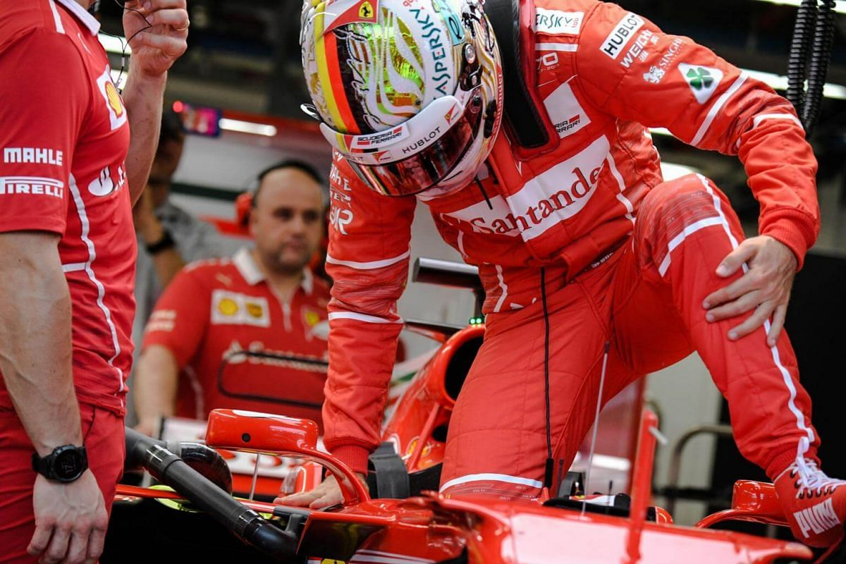 German Formula One driver Sebastian Vettel of Scuderia Ferrari gets back into his car during the third practice session of the 2017 Formula One Singapore Airlines Singapore Grand Prix at the Marina Bay street circuit on Sept 16, 2017.