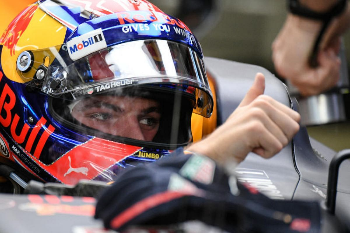 Dutch Formula One driver Max Verstappen of Red Bull Racing Tag Heuer gives the thumbs up to his team as he prepares ahead of the third practice session of the 2017 Formula One Singapore Airlines Singapore Grand Prix at the Marina Bay street circuit o