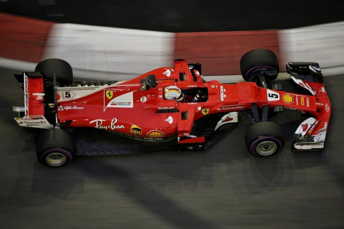 Scuderia Ferrari driver Sebastian Vettel of Germany negotiating Turn 9 during the third practice session of the 2017 Formula One Singapore Airlines Singapore Grand Prix at the Marina Bay street circuit, as seen from Swissotel The Stamford on Sept 16,