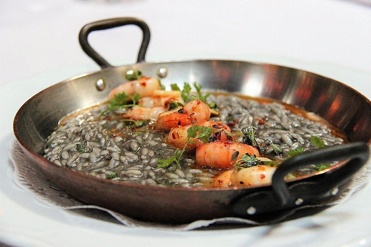 Diners can expect dishes like Nero Risotto (top), where the rice is lightly flavoured with squid ink, and the Miele (above), honey-beetroot cake served warm with espresso sauce.