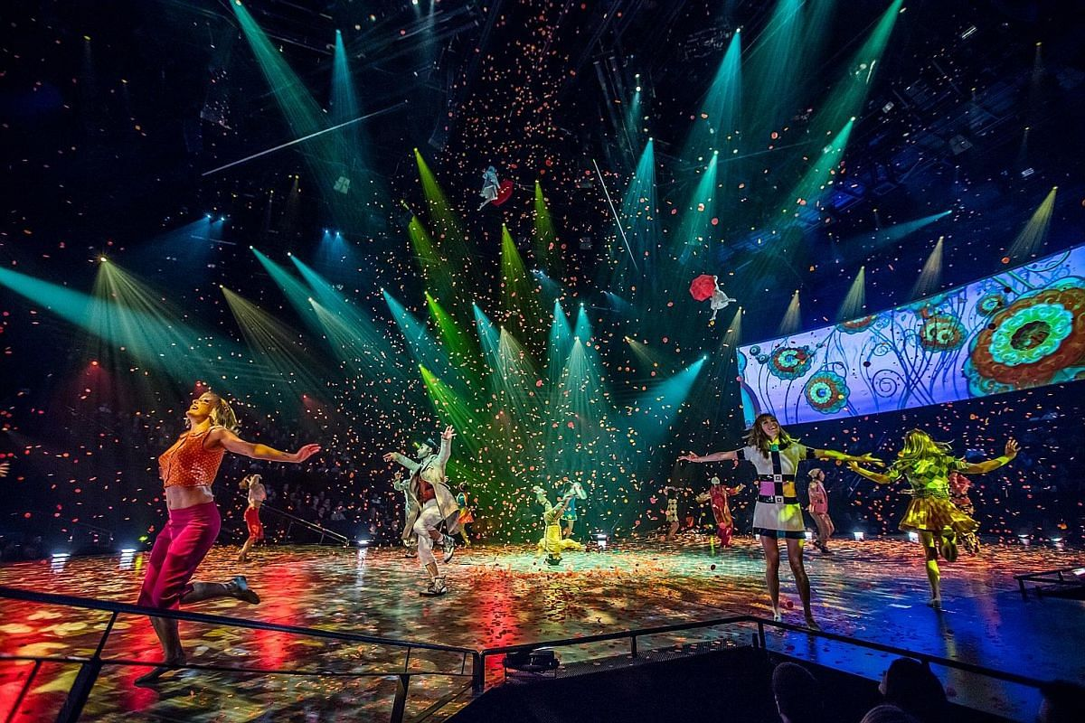 A synchronised swimming performance in the O show at the Bellagio Hotel & Casino in Las Vegas. Left, above: Performers dancing to the tune of The Beatles song Sgt. Pepper's Lonely Hearts Club Band, as confetti rains down, at The Beatles Love show at