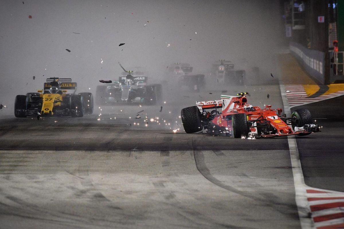 Kimi Raikkonen (right) in a crash during the 2017 Formula One Singapore Grand Prix.