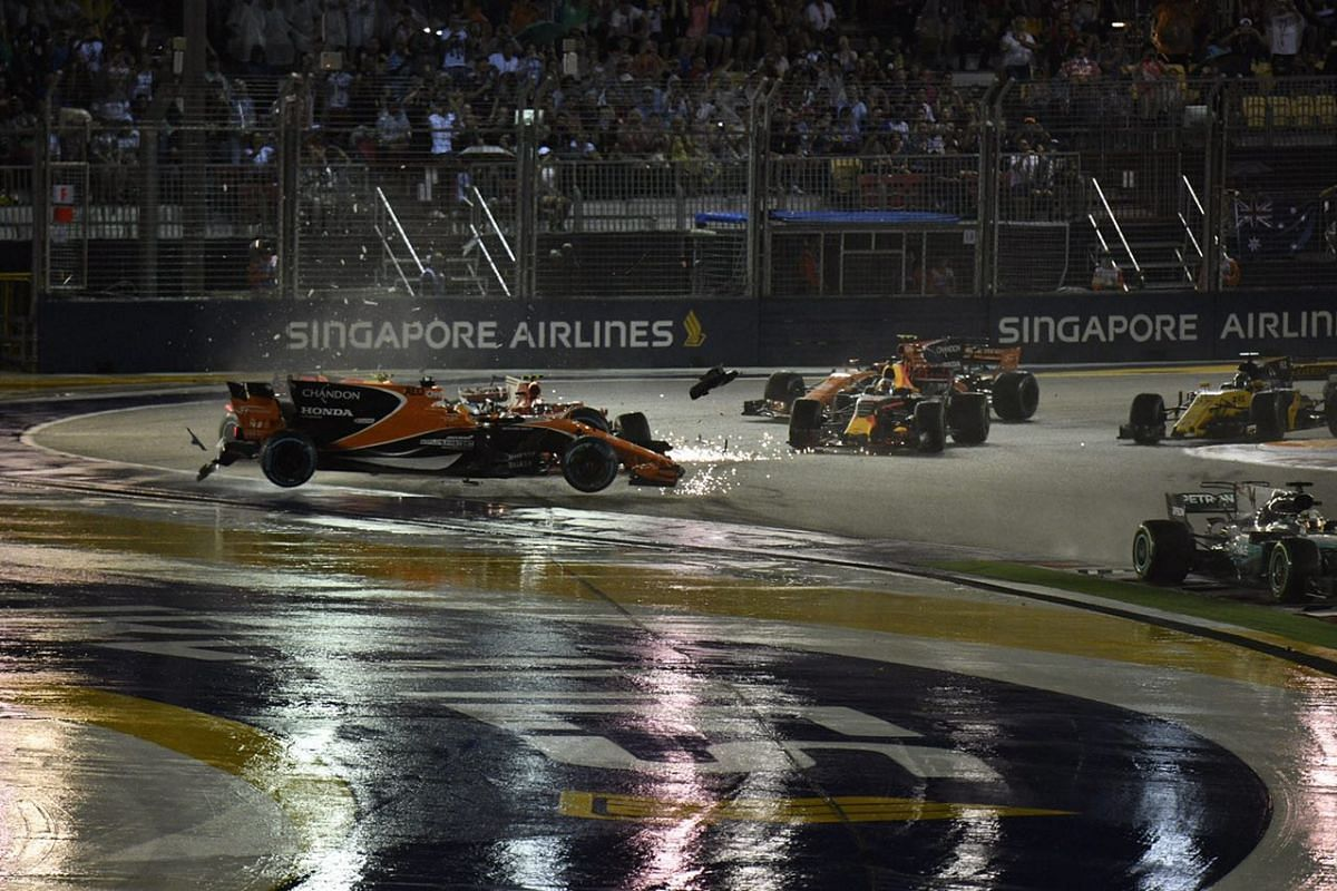 Sebastian Vettel's hopes of vaulting back into the overall Formula One world championship lead were wrecked by a first corner collision on the opening lap of the Singapore Grand Prix on Sunday (Sept 17).
