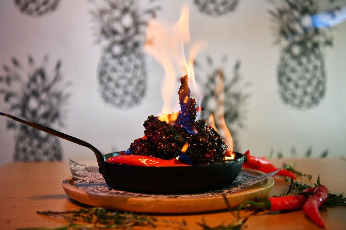 Bird Bird's charcoal-crusted sakura fried chicken (above).