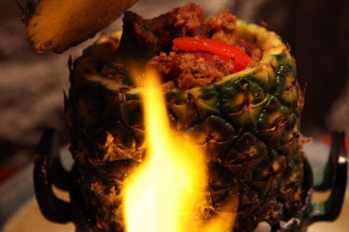 Flaming Pineapple Beef.