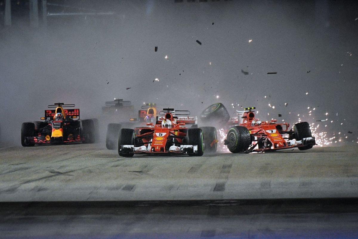 Ferrari's Sebastian Vettel (No. 5) and Kimi Raikkonen (right), and Red Bull's Max Verstappen (behind Vettel) in a crash early in the Singapore Formula One Grand Prix at the Marina Bay Street Circuit in Singapore, 17 September 2017. PHOTO: THE STR