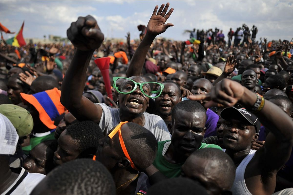 Supporters of Kenya's main political opposition, National Super Alliance (NASA) presidential flag-bearer, Raila Odinga react during a political rally on September 17, 2017 in the Nairobi suburb of Soweto. PHOTO: AFP
