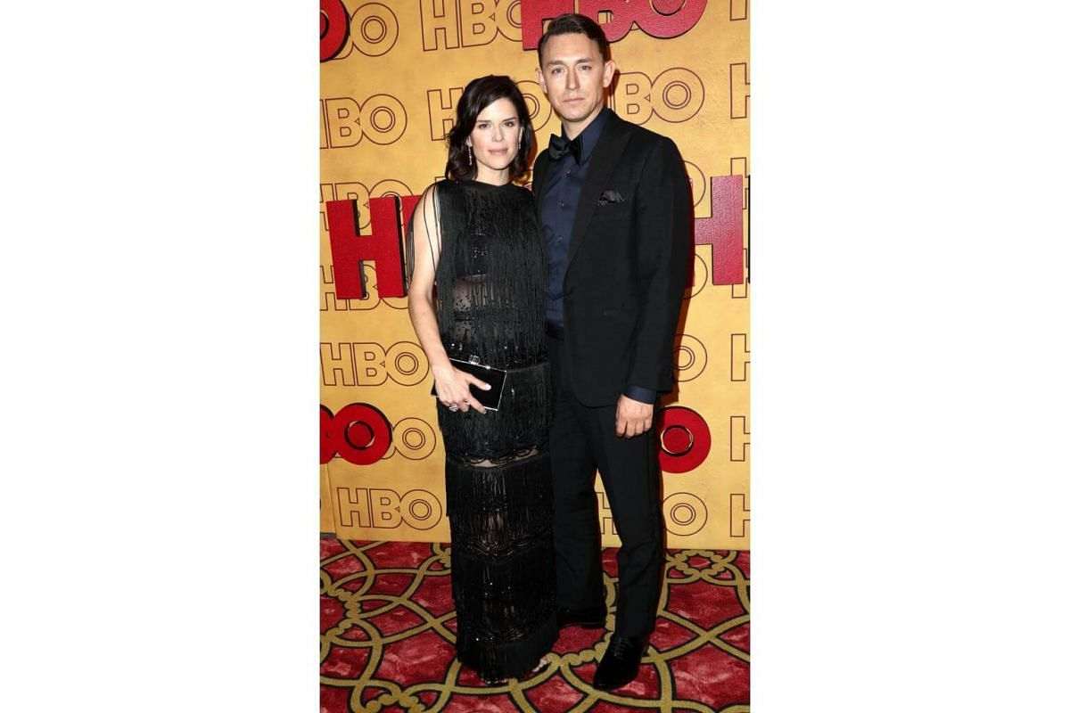 Neve Campbell (left) and JJ Feild attend HBO's Post Emmy Awards Reception at The Plaza at the Pacific Design Center in Los Angeles, on Sept 17, 2017.