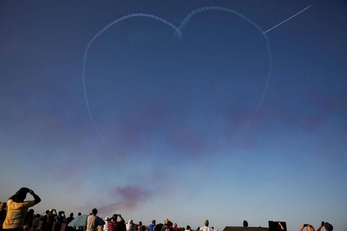 The Red Arrows RAF aerobatics display team forms a heart during performing at the 6th Athens Flying Week aviation event over the Tanagra air base in Athens, Greece, on Sept 17, 2017.