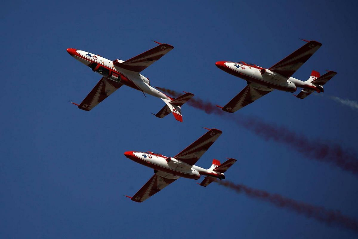 """The Polish Air Forces """"Bialo-Czerwone Iskry"""" aerobatic display team performs during the 6th Athens Flying Week aviation event over the Tanagra air base in Athens, on Sept 17, 2017."""