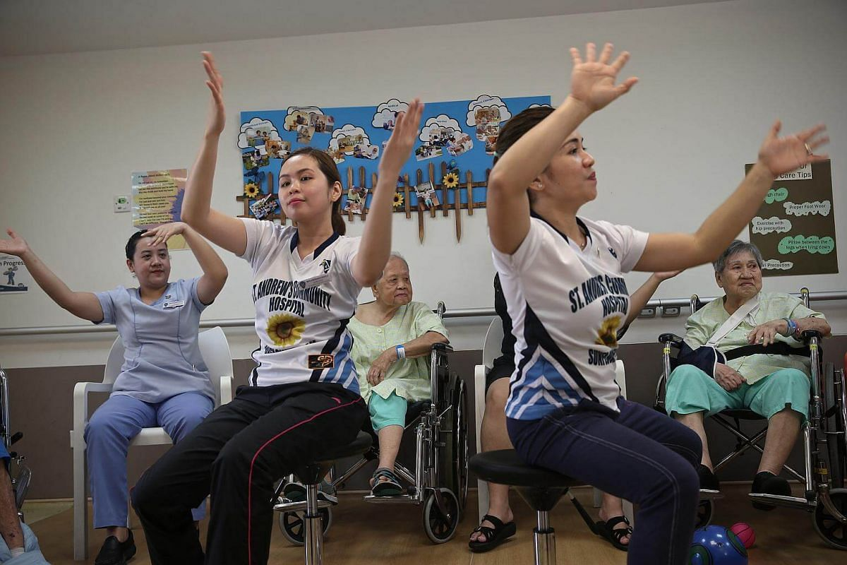 """Led by enrolled nurses Ms Maila Bernades Madelo (second from left) and Ms Vanissa Rose Demetrio (second from right), SACH patients with dementia take part in a programme called """"Everyday Waltzes for Active Ageing"""", which helps to connect everyday act"""