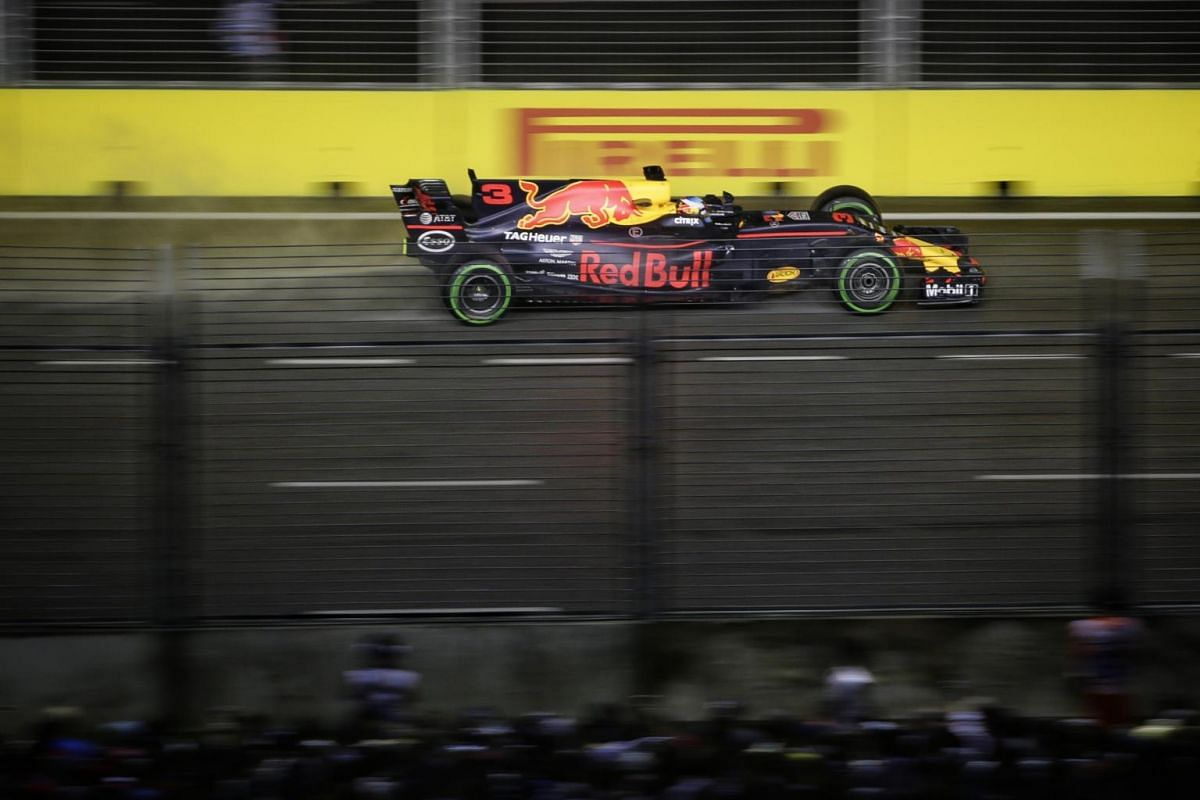 Red Bull Racing driver Daniel Ricciardo of Australia approaching Turn 8 during the 2017 Formula One Singapore Airlines Singapore Grand Prix at the Marina Bay street circuit, as seen from Swissotel The Stamford on Sept 17, 2017.