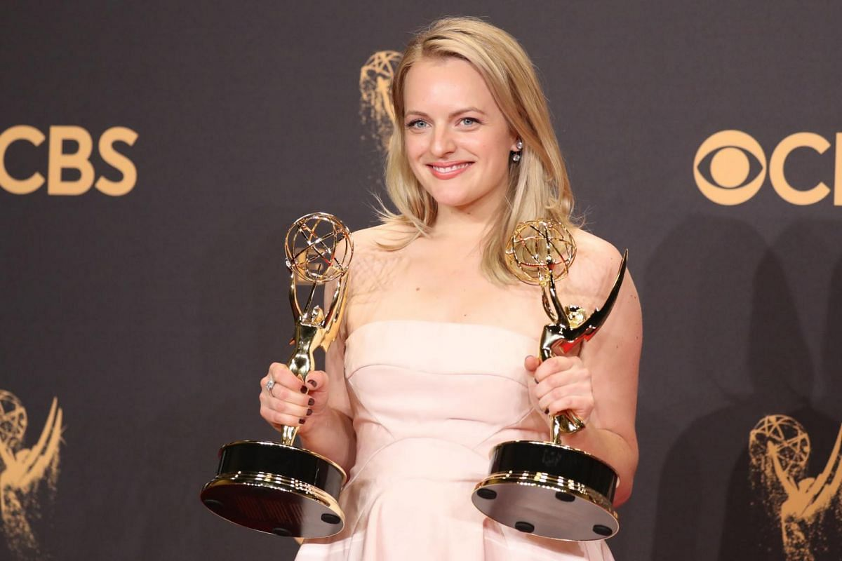 Elisabeth Moss poses with her Emmys for Outstanding Lead Actress in a Drama Series and Outstanding Drama Series for The Handmaid's Tale.