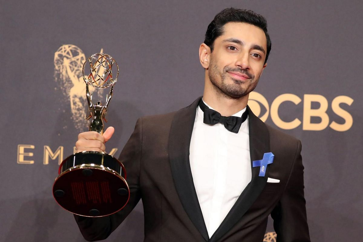 Riz Ahmed poses with the Emmy for Outstanding Lead Actor in a Limited Series or Movie for The Night Of.