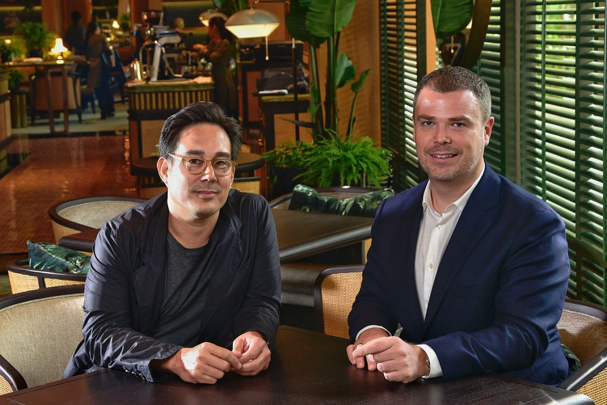 Hassell principals Matthew Shang (far left) and Paul Semple in the Tea Lounge at the Regent Singapore, one of the latest projects they have completed.