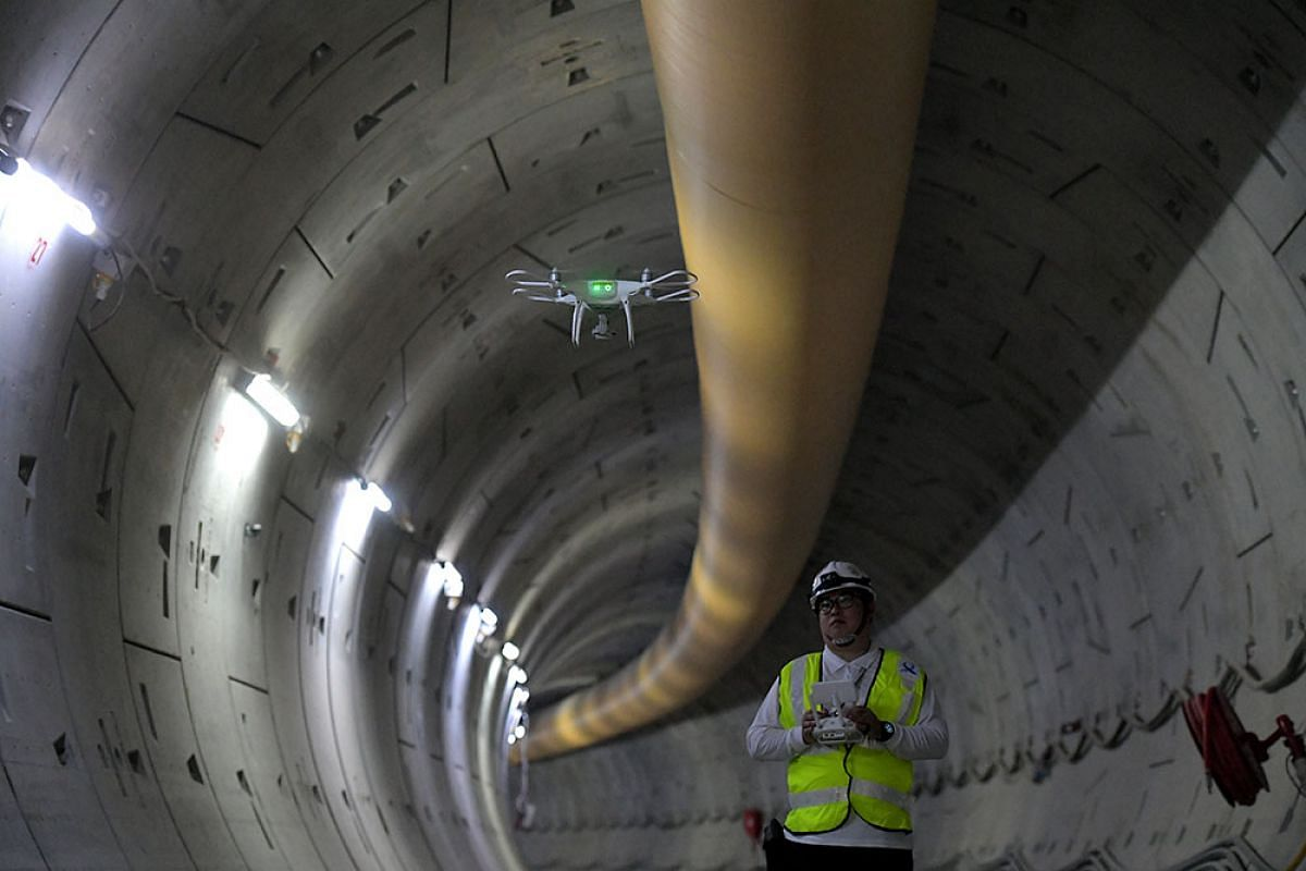 A Land Transport Authority project engineer pilots an aerial drone to inspect construction work in a section of the tunnel for the upcoming Thomson-East Coast Line on Sept 18, 2017. Drones are used to inspect locations that are difficult to access an