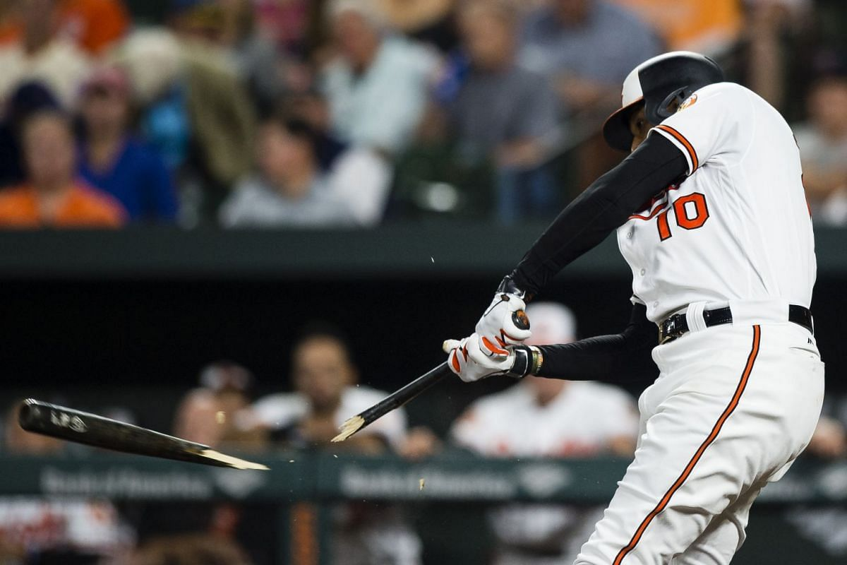 Baltimore Orioles center fielder Adam Jones (10) breaks his bat as he grounds into a fielder's choice to third in the first inning against the Boston Red Sox at Oriole Park at Camden Yards on Sept 18, 2017 in Baltimore, MD, USA. PHOTO: USA TODAY SPOR