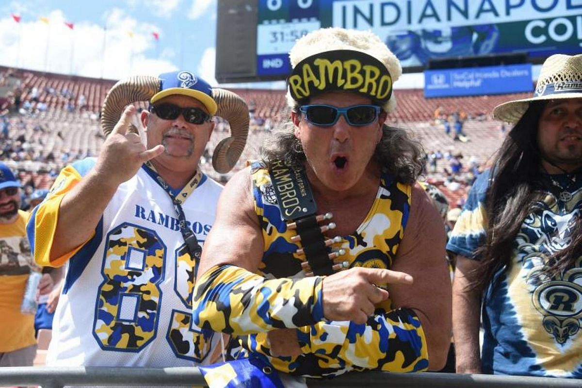 Los Angeles Rams fans cheer before their NFL game against the Indianapolis Colts at Los Angeles Memorial Coliseum.