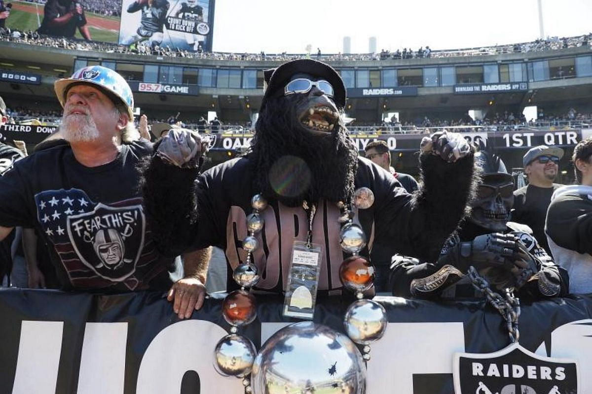 Oakland Raiders fans cheer on their team during the Raiders players introductions before the game between the New York Jets and the Oakland Raiders at the Oakland Coliseum in California, on Sept 17, 2017.