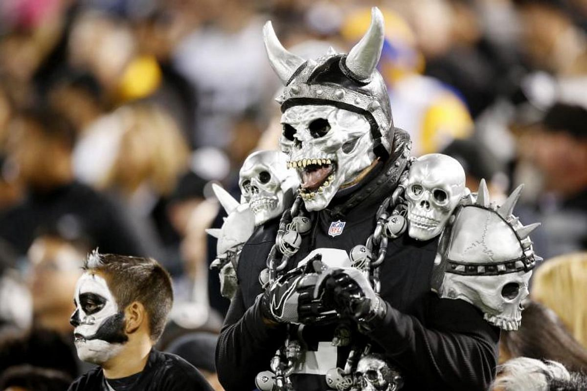 Oakland Raiders fans watch their game against the Los Angeles Rams at Oakland Coliseum.