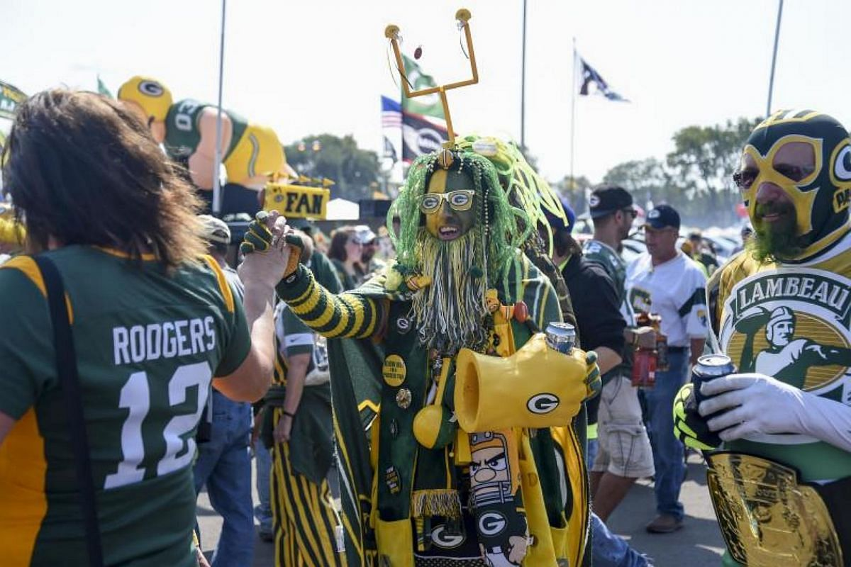 Rob Roskom (centre) greets fans before a game between the Green Bay Packers and Seattle Seahawks at Lambeau Field.