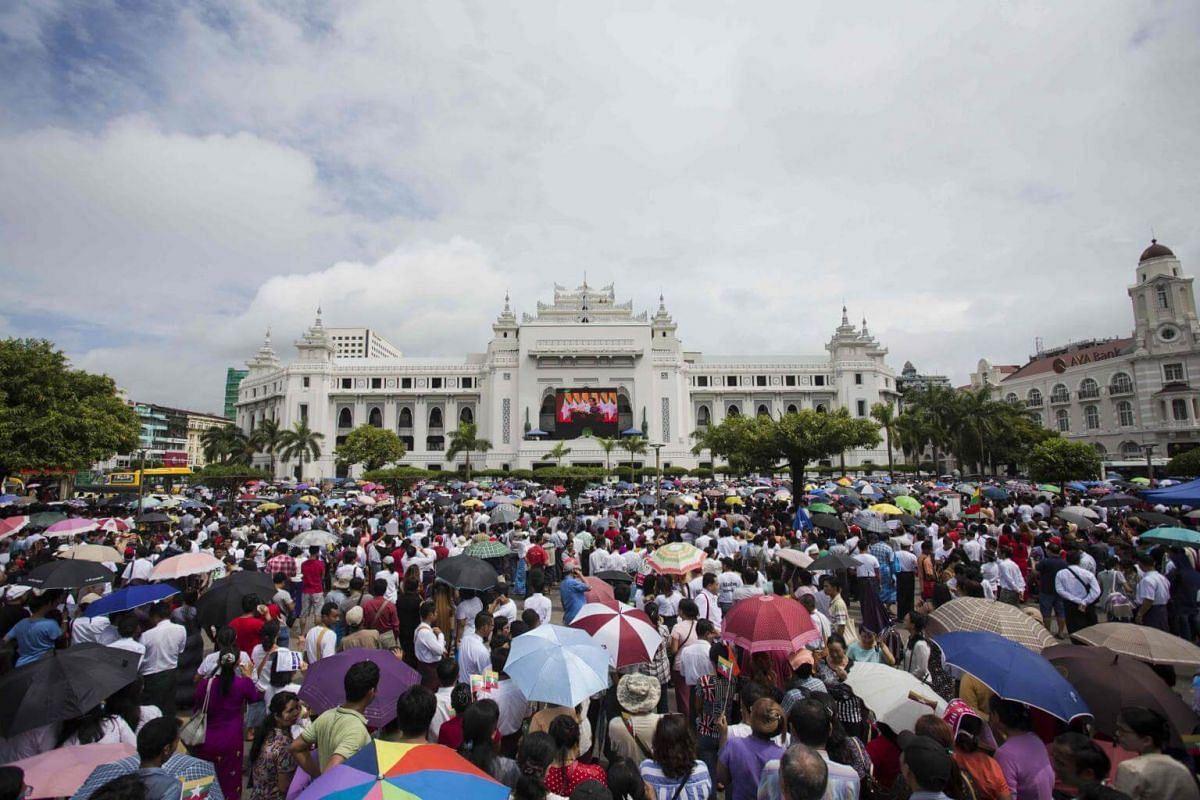 People gather to listen to the live speech of Myanmar's State Counselor Aung San Suu Kyi in front of City Hall in Yangon, on Sept 19, 2017.
