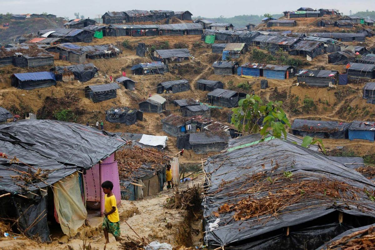 Rohingya refugees play outside their temporary shelters at a camp in Cox's Bazar, Bangladesh, on Sept 18, 2017.