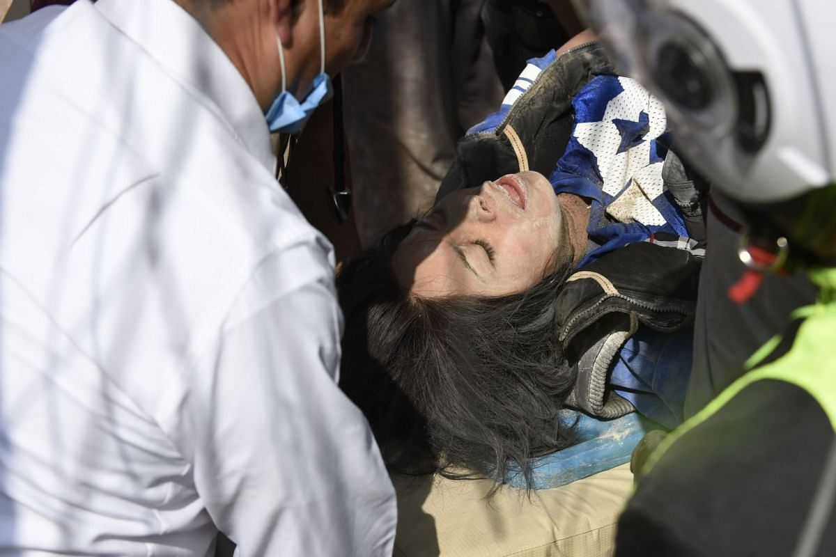 A person rescued from the rubble gets medical assistance after a powerful quake in Mexico City on September 19, 2017. PHOTO: AFP