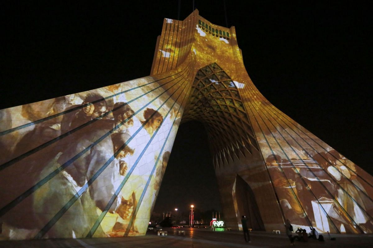 "A visual installation by Iranian artist Amir Reza Salari entitled ""Birds of Peace Light Symphony"" is seen projected on the Azadi Tower, also known as Liberty Tower, in Tehran on September 19, 2017. PHOTO: AFP"