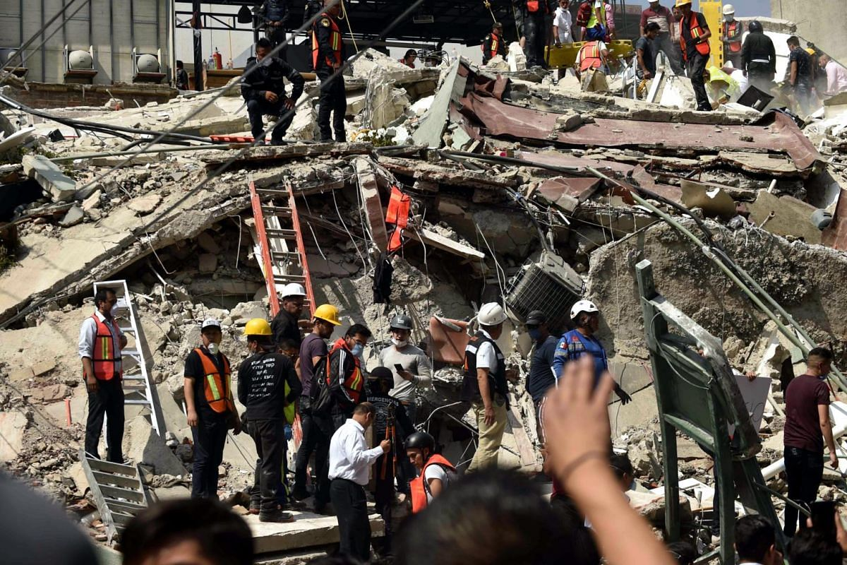 Rescuers working on the rubble from a building knocked down by a powerful quake in Mexico City, on Sept 19, 2017.