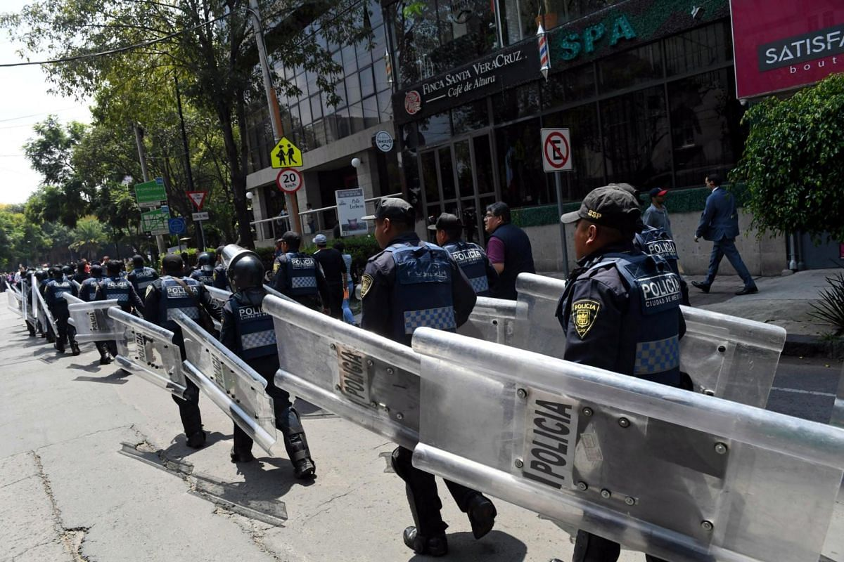 Police officers in riot gear are deployed to prevent looting and disorders after a powerful quake in Mexico City, on Sept 19, 2017.