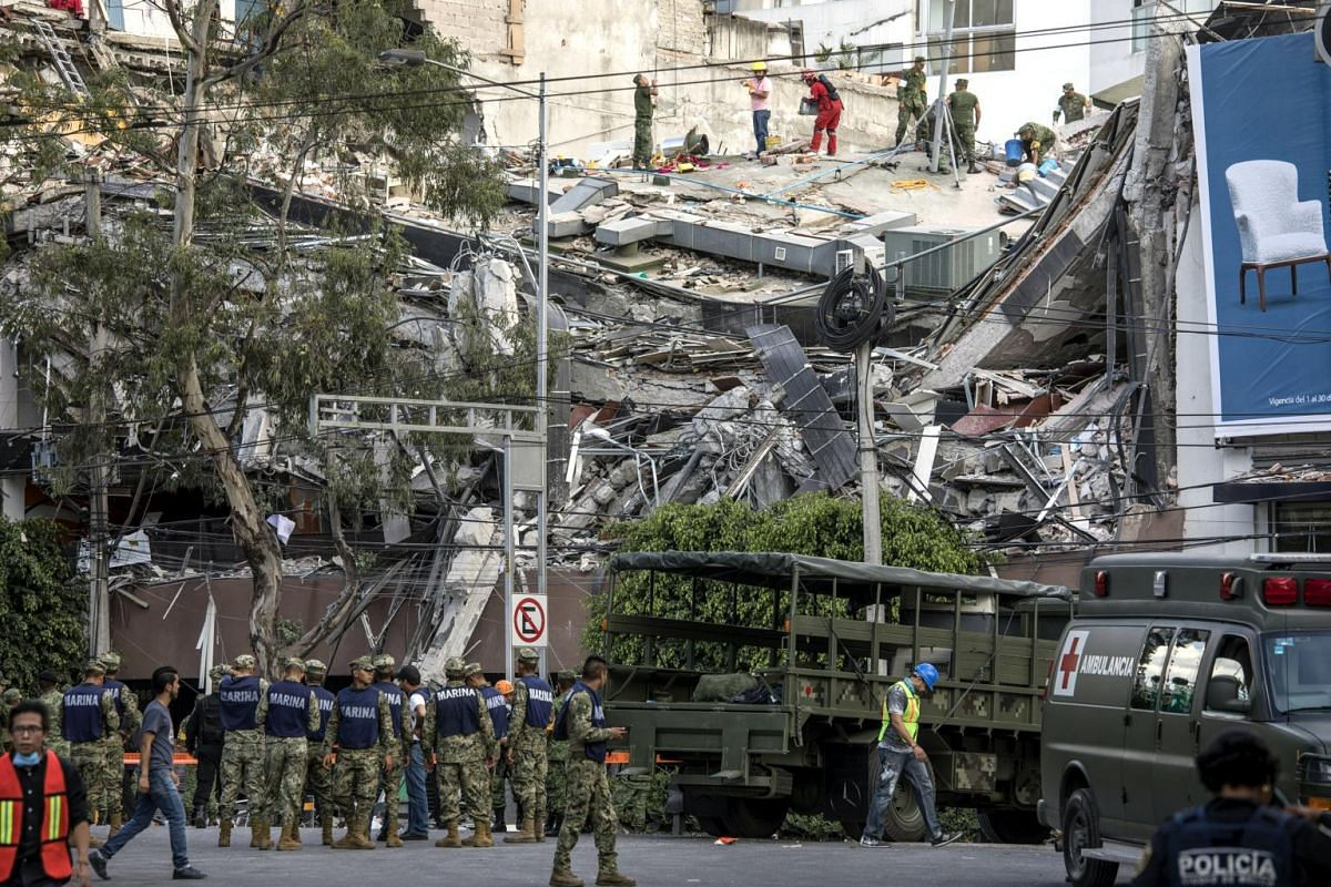 Rescuers working on a collapsed building on Amsterdam Avenue in the Condesa neighbourhood of Mexico City after the earthquake.