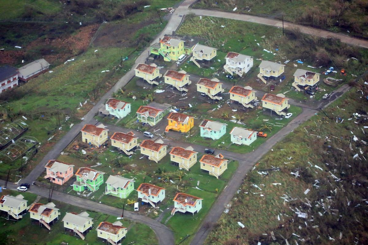 A handout photo released on September 20, 2017 shows damaged homes from Hurricane Maria on the island of Dominica, September 19, 2017. PHOTO: REUTERS/CARIBBEAN DISASTER EMERGENCY MANAGEMENT AGENCY/HANDOUT