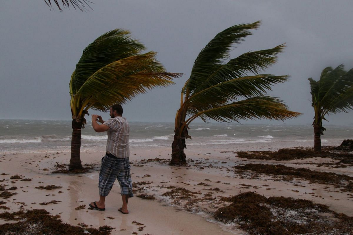 A man photographs the waves before the arrival of Hurricane Maria in Punta Cana, Dominican Republic, on Sept 20, 2017.