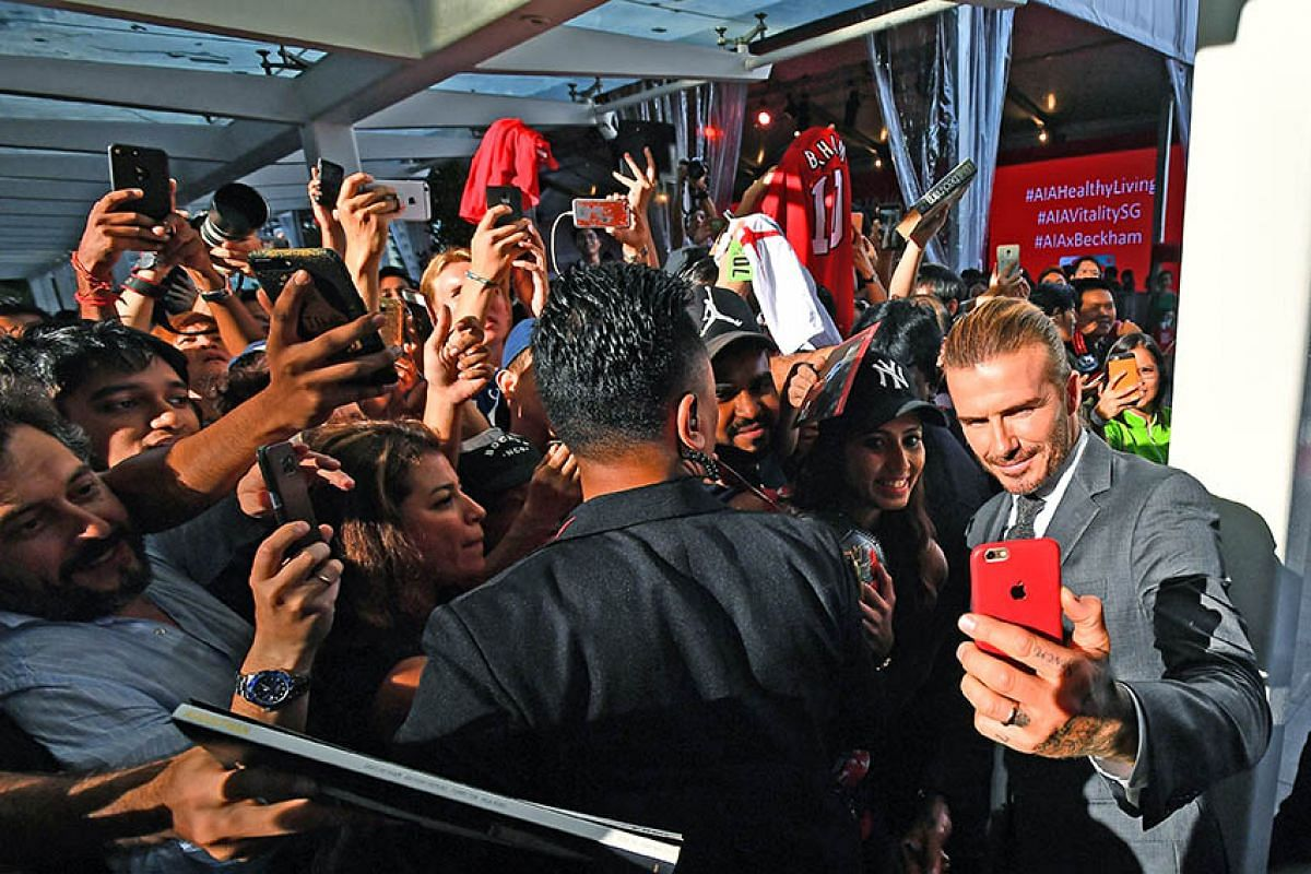 David Beckham, the former England captain and Manchester United superstar was kept busy taking wefies and signing autographs at Clifford Square on September 21, 2017, where he was a guest at insurer AIA's Vitality Healthy Cookout contest, in which